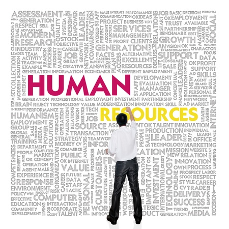 Business man  building word cloud for human resources concept photo