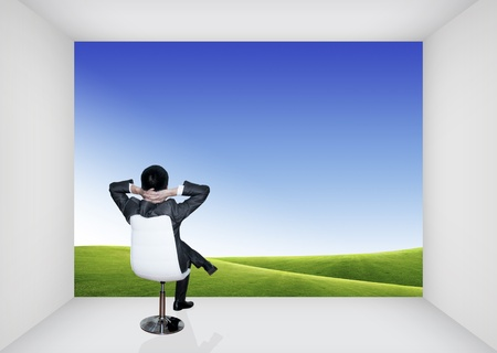 Business man resting on chair in an empty room photo