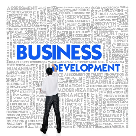 strategic: Business man  building word cloud for business concept