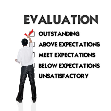 satisfied: Employee evaluation form with business man selecting the choice Stock Photo