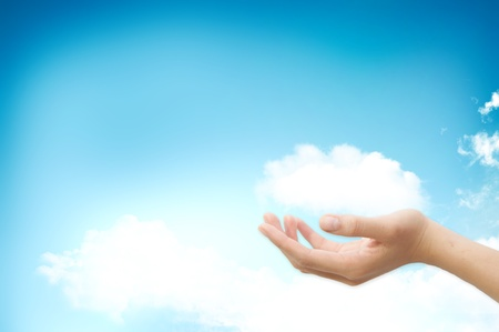 Hand handle cloud against blue sky with clouds on background. For cloud computing and eco concept
