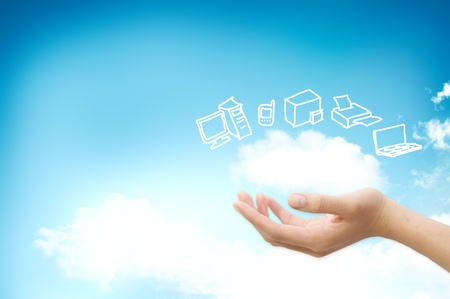 cloud computing concept: Hand handle cloud against blue sky with clouds on background. For cloud computing and eco concept