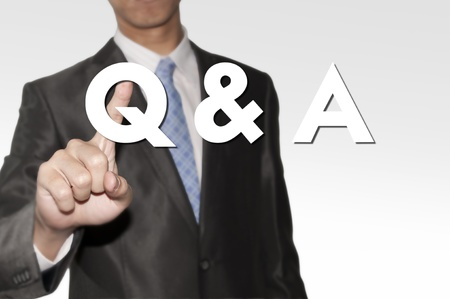 Business man pointing question and answer text  photo