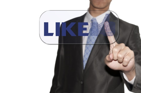 Business man touching the LIKE button Stock Photo - 12351801