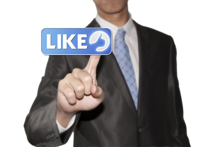 Business man pointing like button