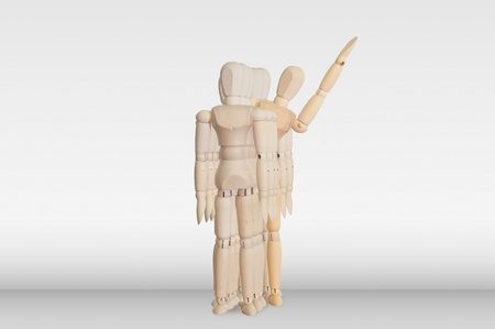 Wooden model in the crowd for human resource concept photo
