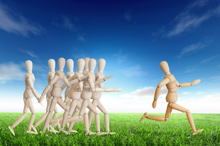 Wooden man run over the crowd for Human Resources concept Stock Photo - 12761685