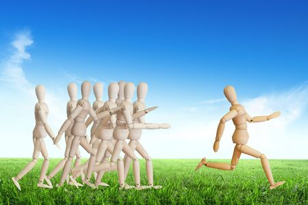 Wooden man run over the crowd for Human Resources concept Stock Photo - 12761464