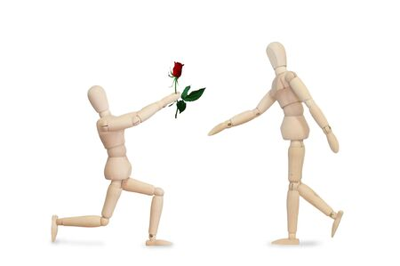 Love surprise flower rose from wooden model couple photo