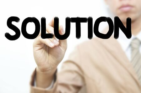 Young business man use hand drawing business word, solution photo