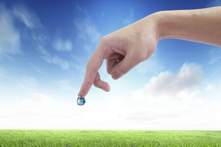handful: Drop of water with Earth inside and hand. The symbol of Save Planet