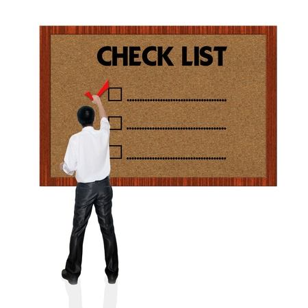 Young business man with mark on the check boxes. Stock Photo - 13774080