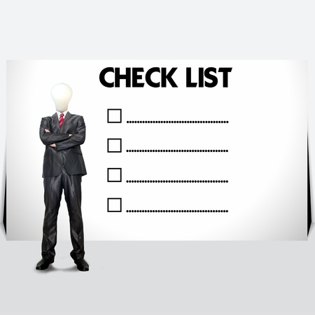 Young business man with mark on the check boxes. Stock Photo - 13773977