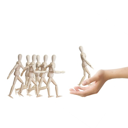 Hand choosing the perfect candidate for the job. Human resource concept photo