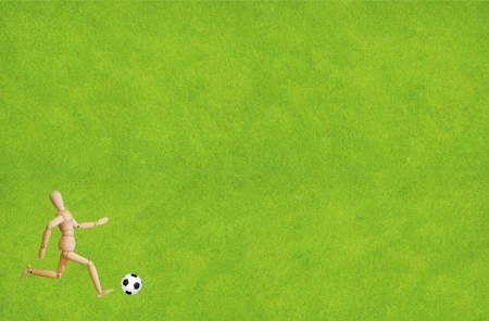 futsal: Wood puppet playing soccer with ball