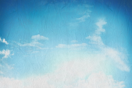 Blue sky with white clouds on texture paper photo