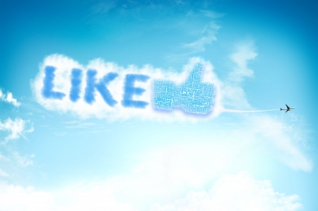 Thumb up like hand symbol with tag cloud of word on the sky Stock Photo - 14107330