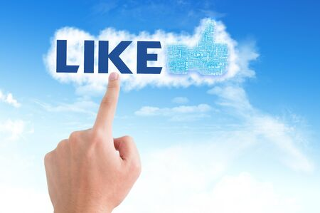 Thumb up like hand symbol with tag cloud of word on the sky Stock Photo - 14107336