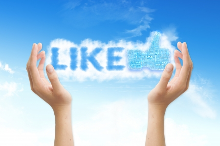 Thumb up like hand symbol with tag cloud of word on the sky Stock Photo - 14107333