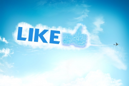 chat up: Thumb up like hand symbol with tag cloud of word on the sky Stock Photo