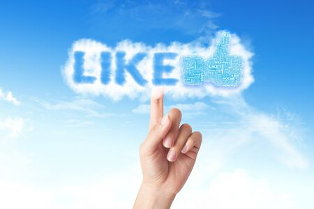 Thumb up like hand symbol with tag cloud of word on the sky Stock Photo - 14107331