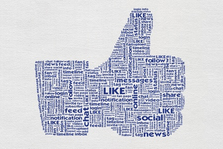 Thumb up like hand symbol with tag cloud of word on paper texture background Stock Photo - 14107488