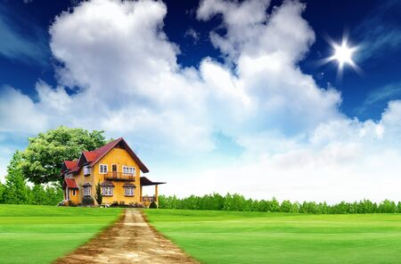 House on green field landscape with bule sky and sun photo