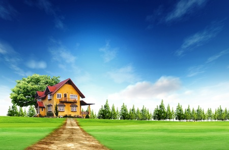 House on green field landscape with blue sky photo