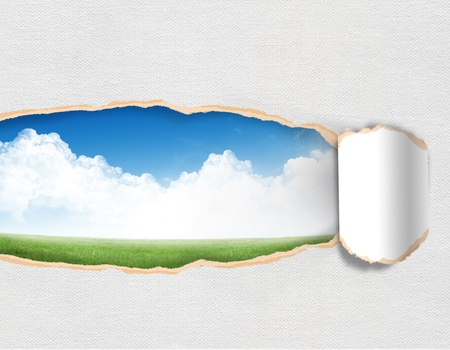 Torn paper with landscape sky in opening background photo