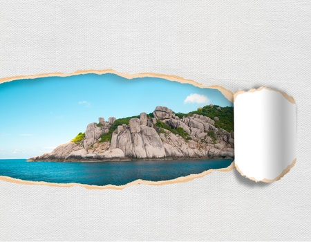 Torn paper with landscape island sky in opening background photo