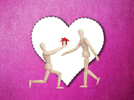 propose: Wooden model handing over love gift to friend on Valentine day