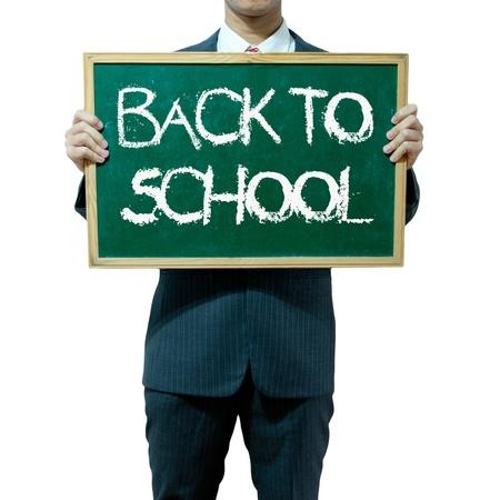 Business man holding blackboard on the background , Education photo