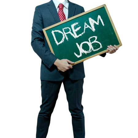 job opportunity: Business man holding board on the background with business word - Dream Job