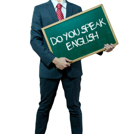 talk to the hand: Business man holding board on the background with business word Stock Photo