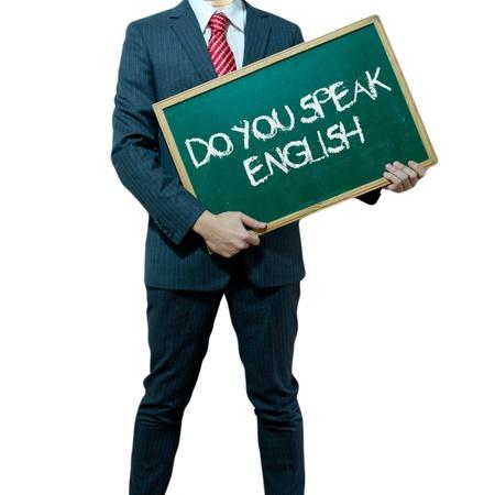 Uomo d'affari che tiene scheda sullo sfondo con la parola commercio Archivio Fotografico - 15356458