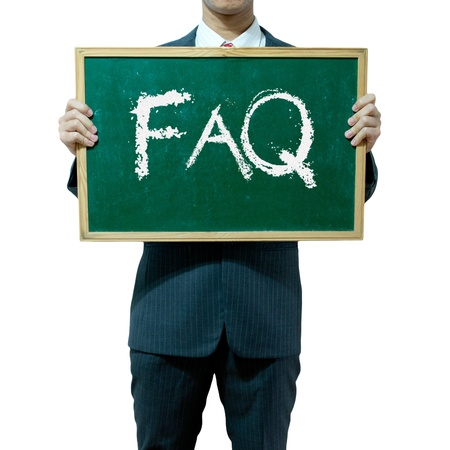 frequently: Business man holding blackboard on the background , FAQ Stock Photo