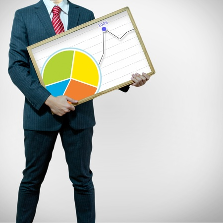 Business man with bukb head holding graph photo