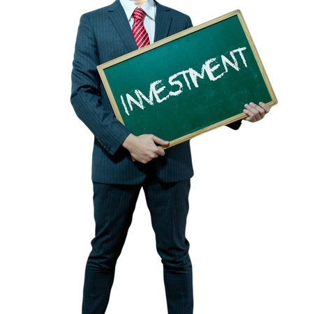 ides: Business man holding board on the background with business word Stock Photo