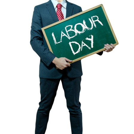 Business man holding board on the background with business word, Labour day