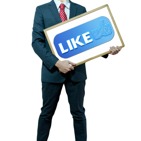 Business man holding board on the background with symbol photo