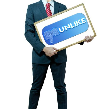 Business man holding board on the background with symbol Stock Photo - 15356350