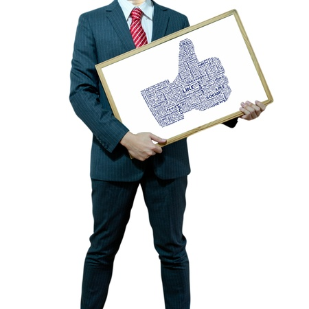 Business man holding board on the background with symbol Stock Photo - 15356438