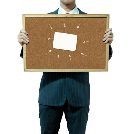 Business man holding cork board on the background  photo