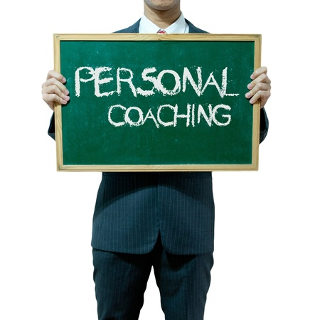 personal growth: Business man holding blackboard on the background , Personal development