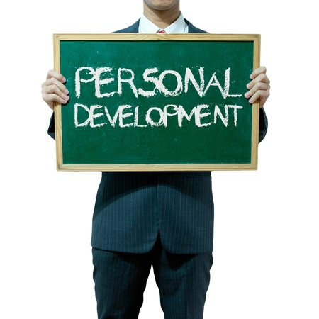 self development: Business man holding blackboard on the background , Personal development