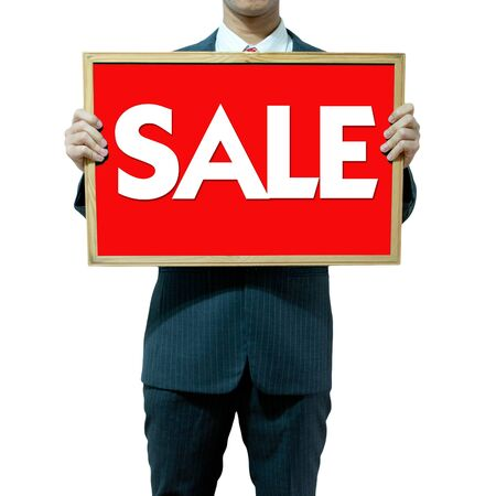 Business man holding board on the background , SALE photo