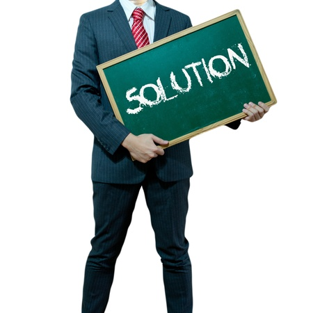 expertise concept: Business man holding board on the background with business word, Solution