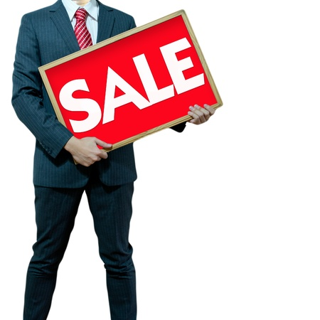 Business man holding black board sale promotion Stock Photo - 15356244