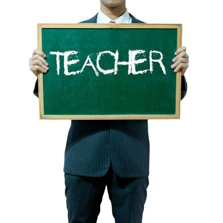 train table: Business man holding blackboard on the background , Teacher Stock Photo