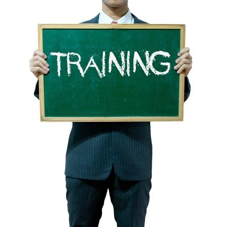 Business man holding blackboard on the background , Training photo